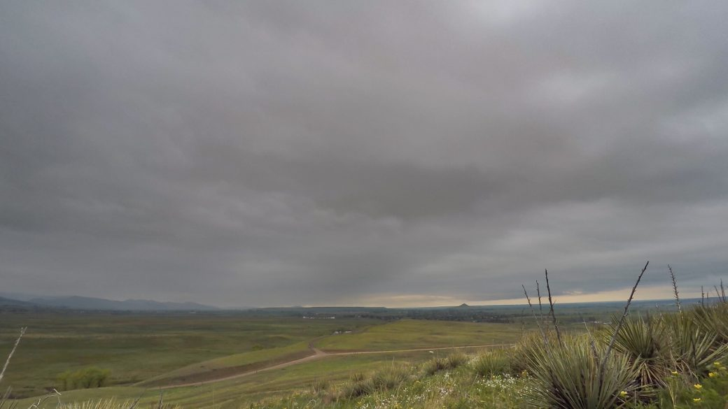 A photograph of altostratus opacus clouds (As op) over a field