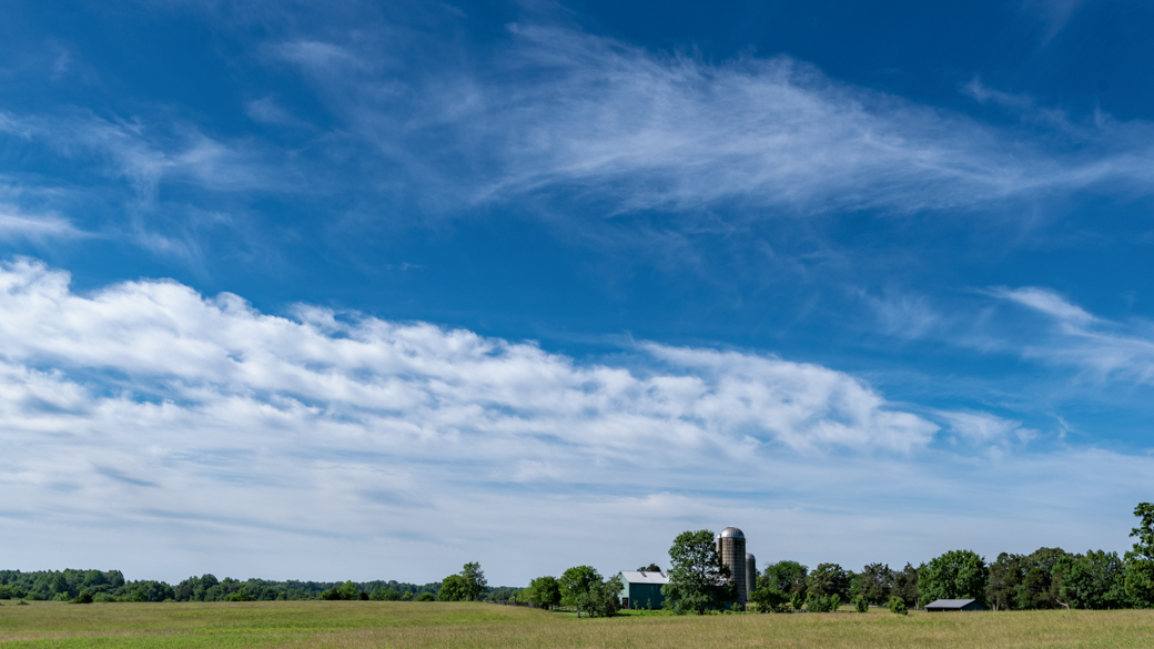 A photograph of a cirrus vertebratus cloud (Ci ve) over a farm in Virginia