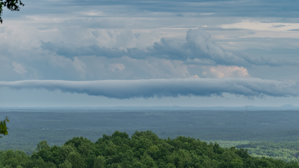 A photograph of a stratocumulus volutus cloud (Sc vol) over a valley